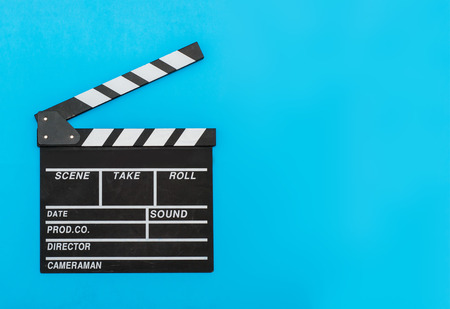 Movie clapper board on blue background Stock Photo