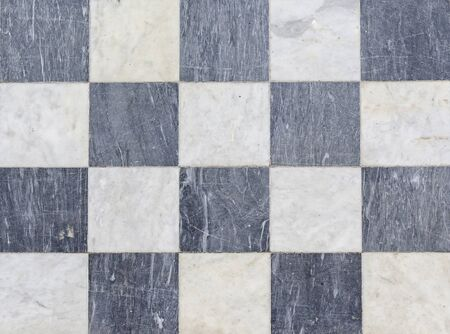 Texture black and white checkered floor tiles, background.