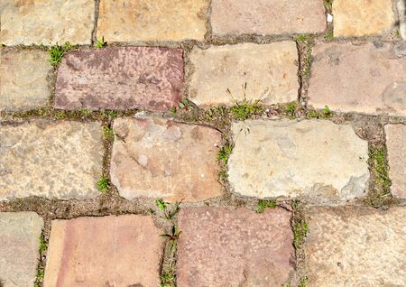 Texture of a fragment of vintage pavement