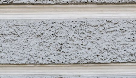 Texture of the gray wall of a baroque building