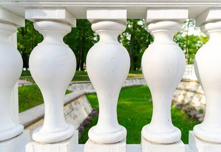 white balustrade on green background