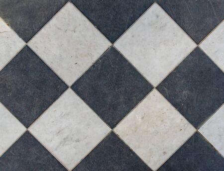 Black and white wintage checkered floor tiles. Reklamní fotografie