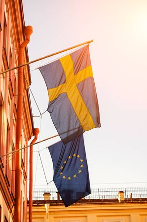 Flags of Sweden and the European Union on the building