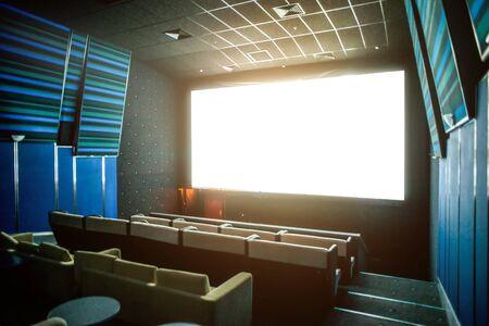 Cinema theatre interior. White screen Imagens