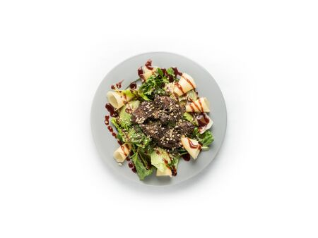 salad with cheese, meat and herbs on a white background