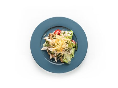 Salad with, chiken, tomatoes and herbs on a white background