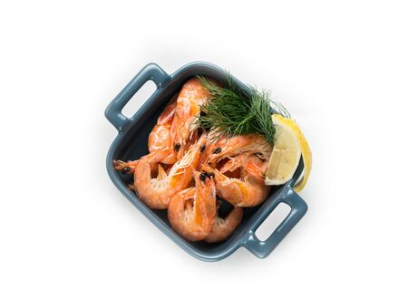 prawns with lemon and dill on white