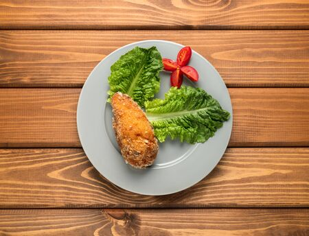 Fried chicken with greens and tomatoes. Stock fotó