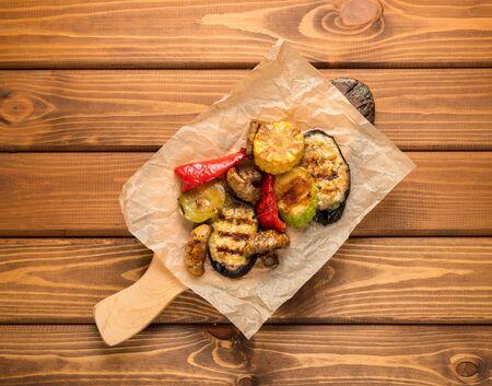 Grilled vegetables grilled. Pepper, eggplant, corn. On wood background