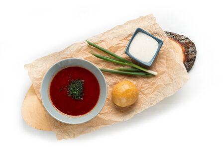 Tasty borsch, onion bun and sour cream isolated on white background Stock fotó