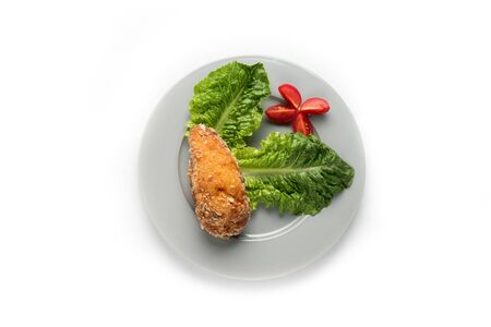 Fried chicken with greens and tomatoes. Isolated on white background Stock fotó