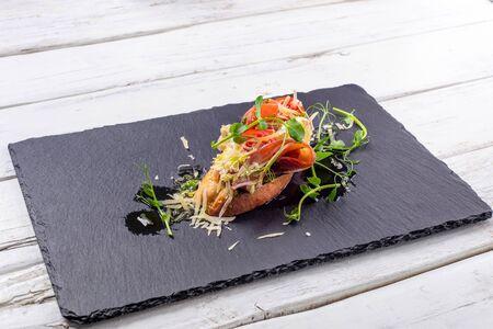 Bruschetta with ham, cheese and pesto 스톡 콘텐츠