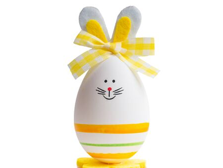 Easter white egg with a smile isolated on a white background Stock Photo