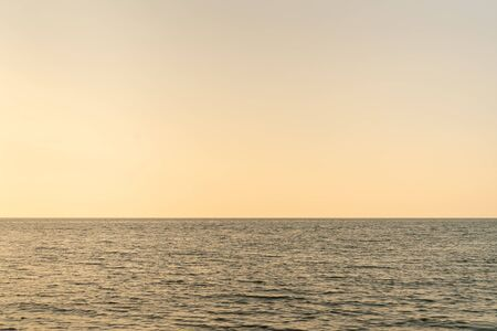 The beautiful clear sky warm sunset sea Stock Photo