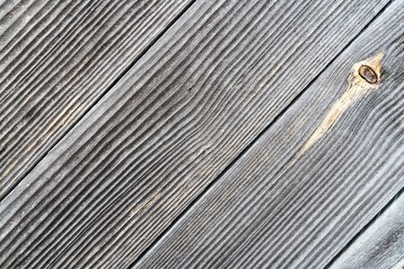 Faded gray diagonal wooden boards