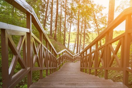 Wooden staircase to the river in the forest Stock Photo