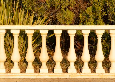 The balusters at sunset. Trees Stock Photo