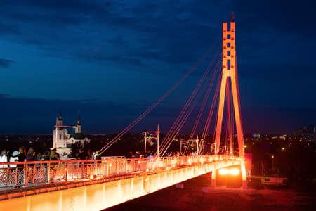 Russia, Tyumen, June 2019: Bridge and night lights, on embankment of Tyumen