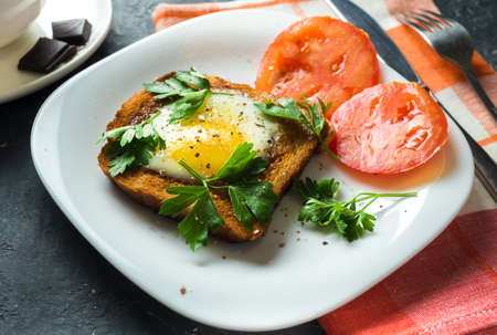 The toast with egg and tomato