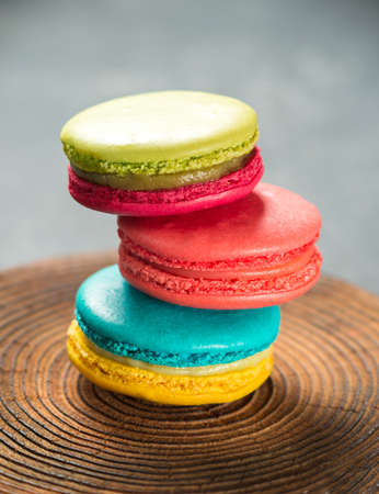 A few colorful makarons on wood