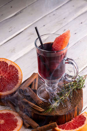 Glass of mulled wine. Spicy citrus warming Autumn and winter drink on white background Stock Photo
