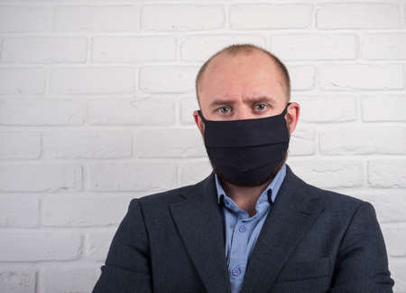 Serious Man in Jacket and Virus Mask