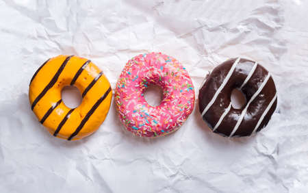 Three donuts on white background