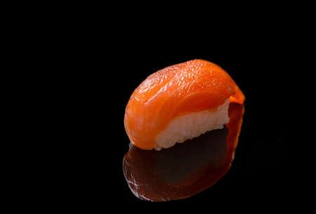 Salmon sushi on black background