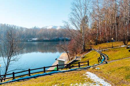 European autumn walking park landscape. View lake and mountains Standard-Bild