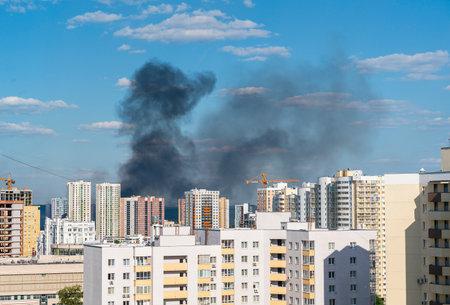 Fire in the city. High-rise buildings Standard-Bild