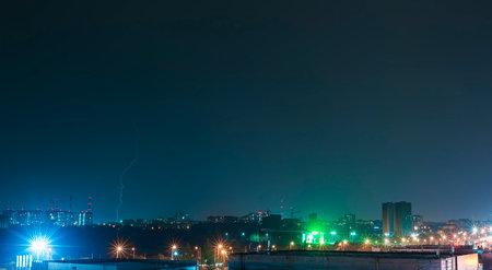 Lightning against the night city