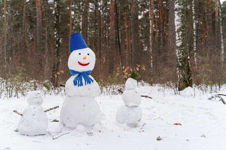 Three funny snowmen in the park