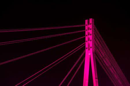 Bridge of lovers with purple illumination in Tyumen. Close up Standard-Bild