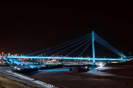 Bridge of lovers with blue illumination in Tyumen