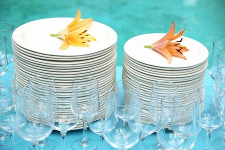 crockery: Stack of white plates and wine glasses Stock Photo