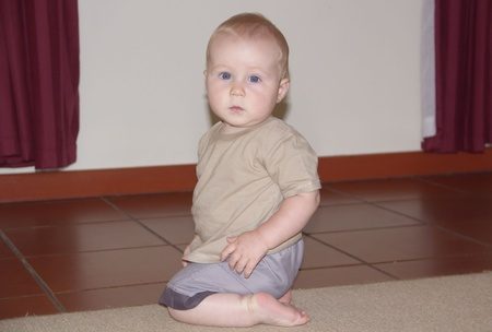 Baby sitting on a floor Stock Photo - 13280069