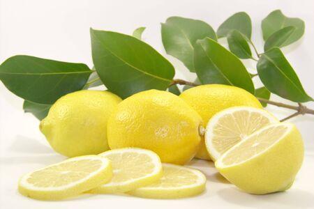 Fresh juicy lemons with leaves Stock Photo