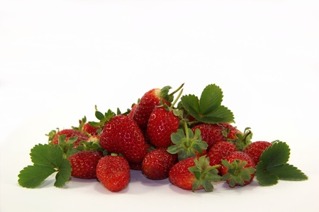 Sweet strawberries with leaves Stock Photo