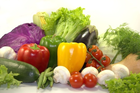 Bright vegetables on white background photo