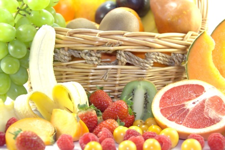 Fruits and berries in the basket Stock Photo