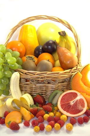 Fresh colorful fruits and berries in the basket Stock Photo - 13595940