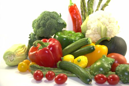 Bright fresh vegetables on white background