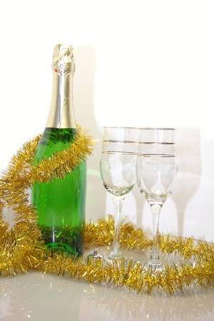 Champagne bottle and glasses with new year decoration Stock Photo