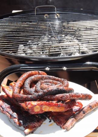 Ribs and sausages on a grill