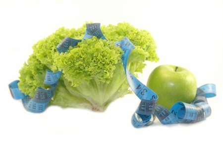Lettuce, green apple and measuring tape isolated on white background