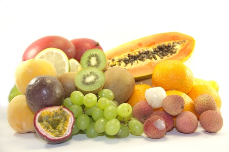 Delicious fresh fruits on white background photo