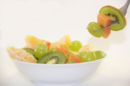 Fresh fruit salad in a white plate photo