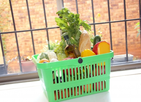 Food in a green plastic basket  photo