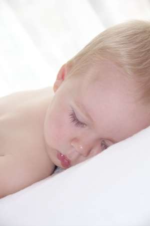 Cute little boy is sleeping photo