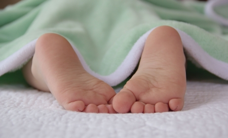 Cute little feet of a sleeping baby
